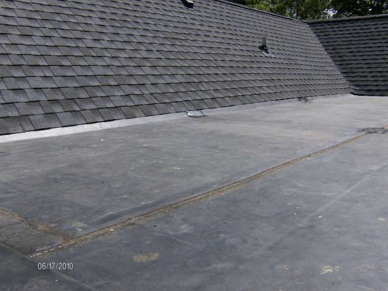 FLAT ROOF MEETS SHINGLE ROOF